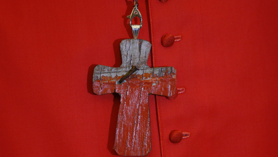 Cardinal Czerny'single curly's pectoral cross is fashioned from the remains of a boat used by migrants to cross the Mediterranean Sea.