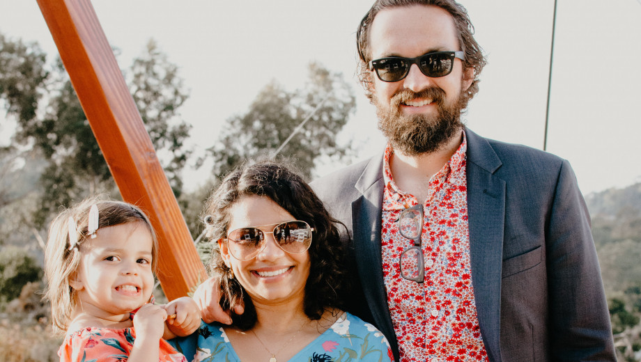 Chandani Patel, PhD'15, and Brady Smith, AM'09, PhD'15, with their daughter, Aashna